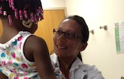 In a three-part series on children with HIV, Dr. Kathy Ferrer carries Simone, 3, at Childrens National Medical Center.
