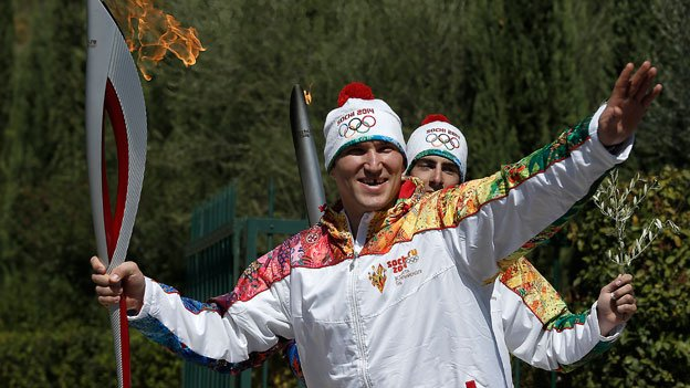Second torchbearer Alexander Ovechkin of Russia leaves the monument of Pierre de Coubertin during the torch relay after the ceremony of lighting of the Olympic flame at Ancient Olympia, in west southern Greece.