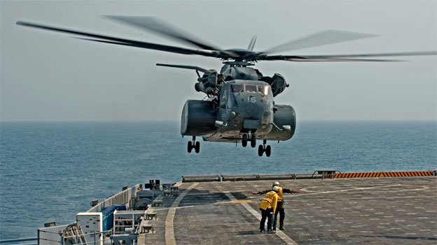 The MH-53E helicopter is nearly 100 feet long and can travel at a speed of 172 miles per hour.