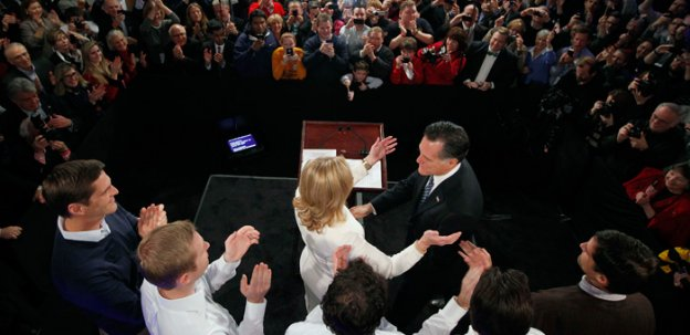 Former Massachusetts Gov. Mitt Romney reaches for his wife Ann as his sons, Josh, Ben, Craig, Tagg and Matt (L-R) look on during the Romney for President New Hampshire primary night rally at Southern New Hampshire University in Manchester, N.H., Tuesday, Jan. 10.