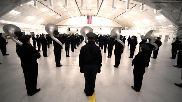 The 99 piece Air Force band practices in a hangar in preparation for their parade performance on Inauguration Day.