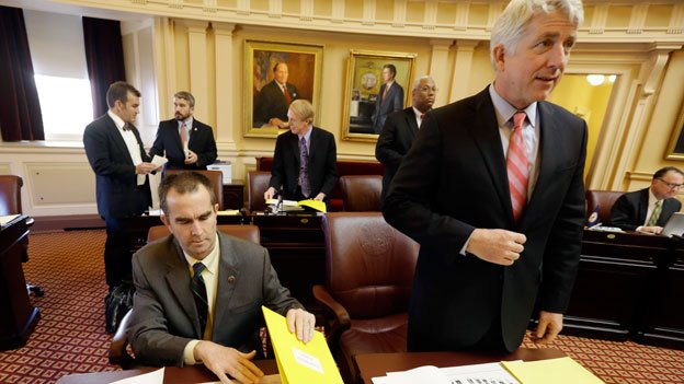 Lt. Gov-elect, Ralph Northam, left, and Attorney General-elect, Mark Herring, right, prepare for the start of the Senate session during opening ceremonies of the 2014 General Assembly at the Capitol in Richmond, Va., Wednesday, Jan. 8, 2014. Both Northam and Herring are being replaced via special election.
