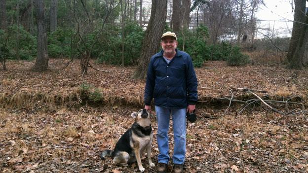 Tom Salvetti and his dog Kelsey in 'Tysons' last forest.'