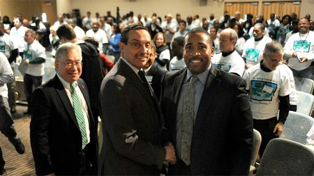 D.C. Mayor Vincent Gray shakes hands with Keith Anderson, who was just appointed director of the District Department of Environment.