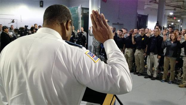 MPD Lt. Kervin Johnson swears in hundreds of members of the National Guard at the D.C. Armory.