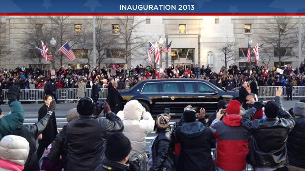 Crowds line the parade route as the presidential limo passes by during the Inauguration Day parade.