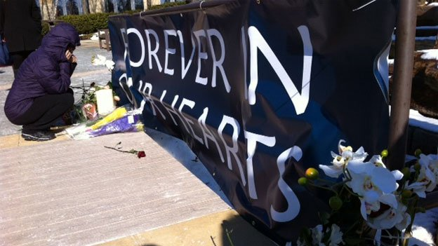 A memorial to the victims of the Columbia Mall shooting has been erected near the mall's fountain.