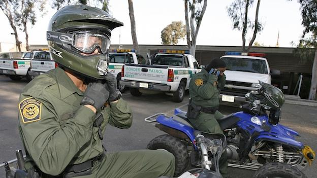 U.S. Border Patrol Agent Brian Ratz, left, and Shone Sessions, right, both wearing the new border patrol uniform, get ready for their shift on their all-terrain vehicles at the Chula Vista Sector Border Patrol Station in San Diego, Thursday, Aug. 16, 2007.