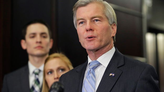 Former Virginia Gov. Bob McDonnell makes a statement as his daughter, Cailin and her husband, Chris Young, listen during a news conference in Richmond, Va., Tuesday, Jan. 21, 2014.