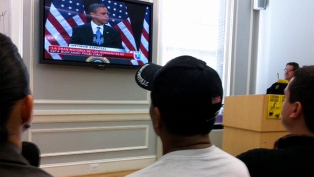 Immigration advocates at Casa de Maryland watch the president's remarks from Las Vegas.