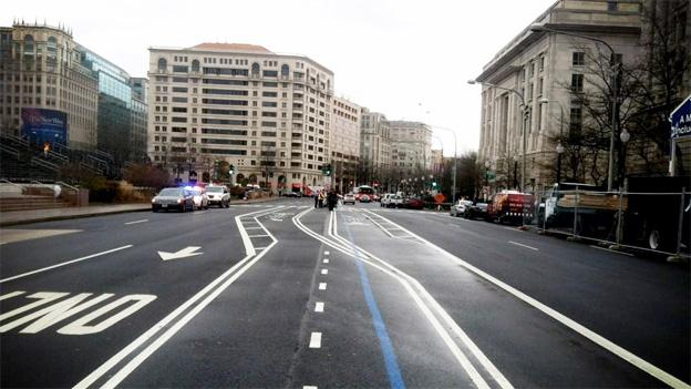 The bicycle lanes in the middle of Pennsylvania Ave. are off-limits to cars, as DDOT officials warner motorists Wednesday.