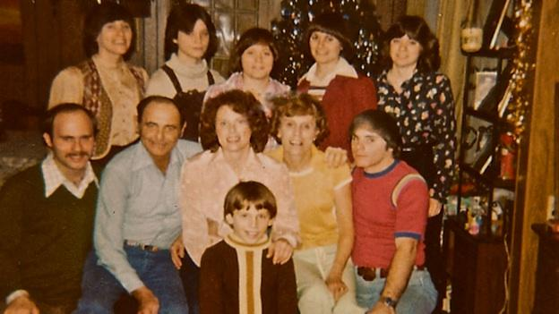 Steve Lickteig (front, center) always thought he was a stranger adopted into the Lickteig family; at age 18, he found out his adopted parents were actually his grandparents. His mother was his supposed sister, Joanie (middle row, center).