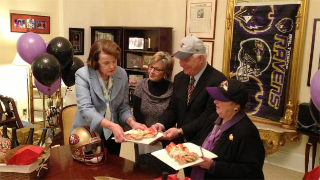 From the left, California Sens. Dianne Feinstein and Barbara Boxer serve crab to Maryland Sens. Ben Cardin and Barbara Mikulski.