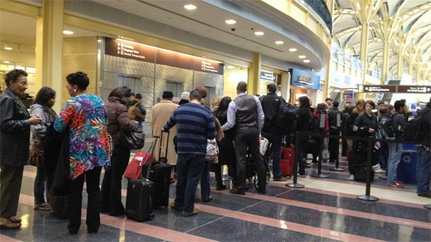 Ronald Reagan Washington National Airport is packed with travelers put out by the looming snowstorm.