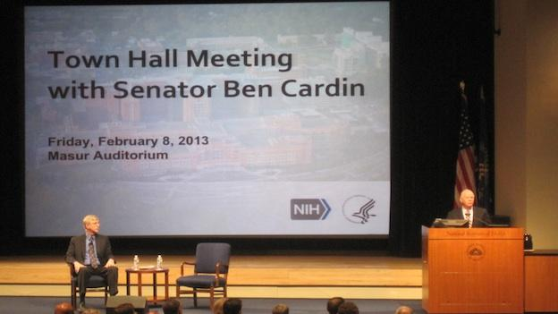 Maryland Sen. Ben Cardin speaking at the podium at the National Institutes of Health in Bethesda, Md. on Friday, Feb. 8, 2013.