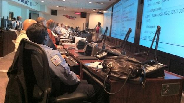 D.C. police officers get briefed on the latest incidents and initiatives to address crime throughout the District.