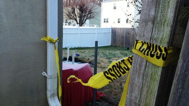 A view of the backyard of the house where a shooter allegedly shot two people, killing one, and then killed himself last night in College Park, Md.