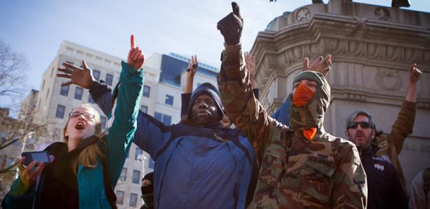 For so many reasons, Americans are seething. Protesters chant in protest at Occupy DC's McPherson Square encampment days before being evicted en masse by National Park Police.