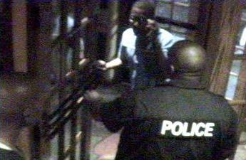 This image made from surveillance video provided by Prince George's County Police shows Cyril Williams, background, in the slaying of off-duty Maryland state Trooper 1st Class Wesley W. Brown, right. The image is from the doorway of an Applebee's restaurant in Forestville, Md. on Thursday, June 10, 2010 where Brown was working as a security guard.