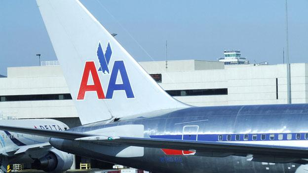 American Airlines and US Airways have approved a merger, a move that would create the largest airline in the world.