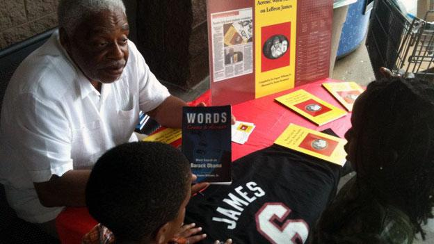 Eugene Williams talks to young students about vocabulary and his book 'Word Cross and Across.'
