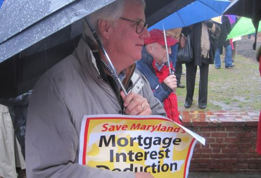 Maryland real estate agents and brokers braved the rain Wednesday in front of the State House to protest the governor's plan to cap mortgage interest deductions.