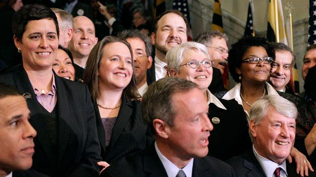 Rep. Heather Mizeur, D-Montgomery, top left, stands with other openly gay members of the Maryland General Assembly as Maryland Gov. Martin O'Malley signs the state's same-sex marriage bill into law.