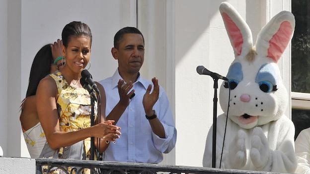 President Barack Obama and first lady Michelle Obama stand with the Easter Bunny at the White House Easter Egg Roll on the South Lawn of the White House in Washington, Monday, April 25, 2011.