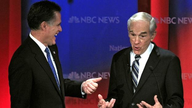 Republican presidential candidates, Rep. Ron Paul, R-Texas, right, and former Massachusetts Gov. Mitt Romney share a laugh during a break in a Republican presidential debate at the University of South Florida in Tampa, Fla.