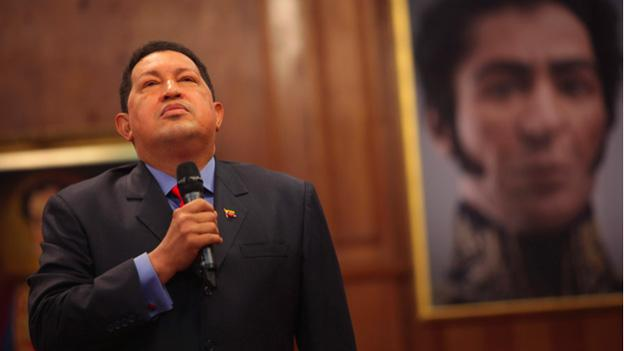 Standing next to a portrait of independence hero Simon Bolivar, Venezuelan President Hugo Chavez speaks during a press conference in Caracas in October 2012.