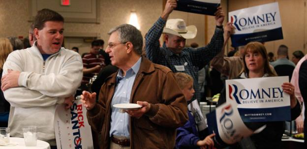 Santorum supporters Daren Ward, left, of Edmond, Okla., and Wes Lavin, right, of Oklahoma City, talk as Romney supporters hold signs at rear, at a Republican watch party in Oklahoma City, Tuesday, March 6.
