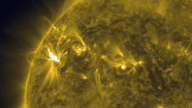 Satellite image of solar flares that erupted Tuesday.