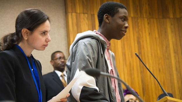 Tyriek Mack, a junior at School Without Walls in the District, played a prosecutor in the mock trial, with a little help from lawyer Hala Mourad (left).