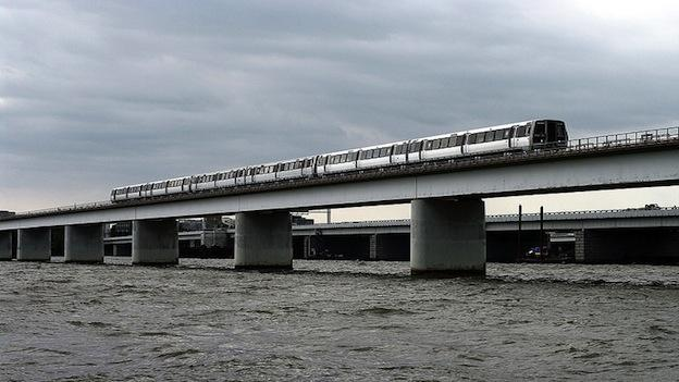 A Metrorail train riding over the Potomac River.