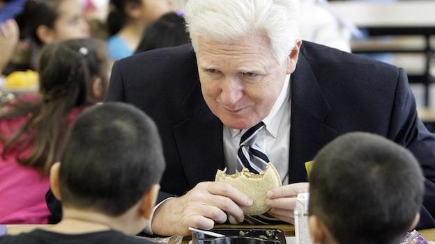 Rep. Jim Moran, D-Va., talks with children as he eats lunch with them after attending an event at a flu vaccination clinic at Carlin Springs Elementary School in Arlington, Va., Thursday, Jan. 7, 2010.