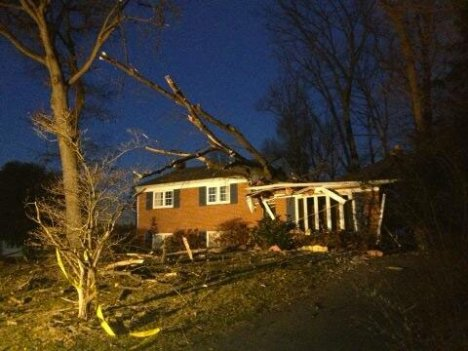 A large tree crashed down on a house in Silver Spring, Md., overnight on March 13, 2014.