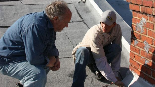 Bobby Hight, an auditor with Ardent 360, right, conducts an energy assessment of Steve Cox's home.