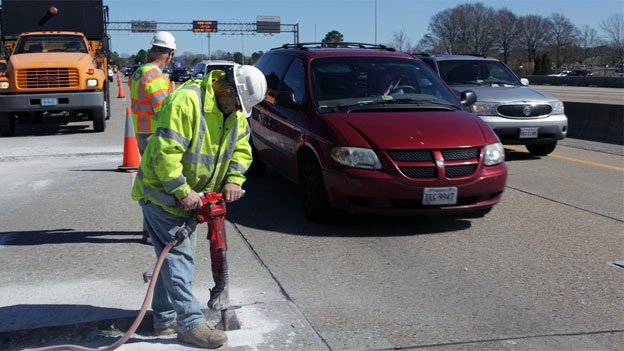 A pneumatic jackhammer is used to carve out potholes before they can be filled with asphalt in Virginia.