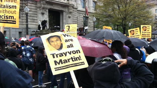 Hundreds of protesters rallied in Freedom Plaza Saturday in honor of the Florida teen who was shot and killed last February.