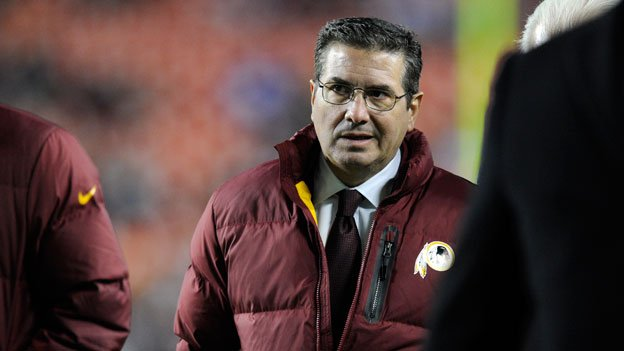 Washington Redskins owner Dan Snyder walks off the field before an NFL football game against the New York Giants Sunday, Dec. 1, 2013, in Landover, Md.