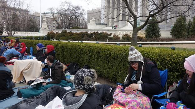 More than two dozen people bundled up to camp out before the U.S. Supreme Court for a seat to watch oral arguments in a same-sex marriage case on Tuesday.