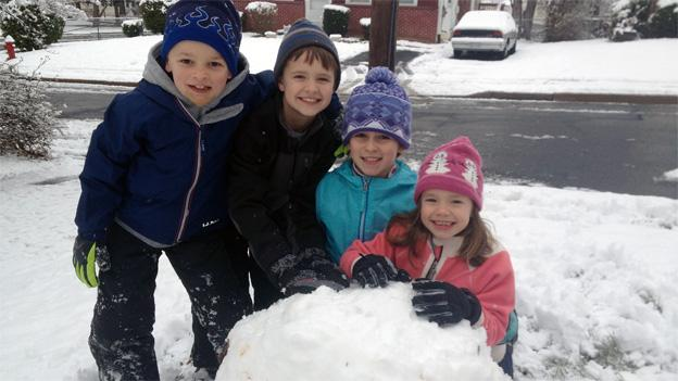 "Taking advantage of the Spring Break snow, the Kale family from Vienna, Va., work together to build ""Bob"" the snowman."