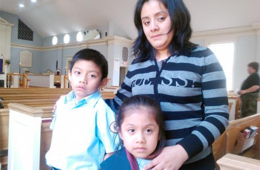 Cindy De Leon with her children David, 7, and Evelyn, 5, in their Adventist church in Arlington, Va.