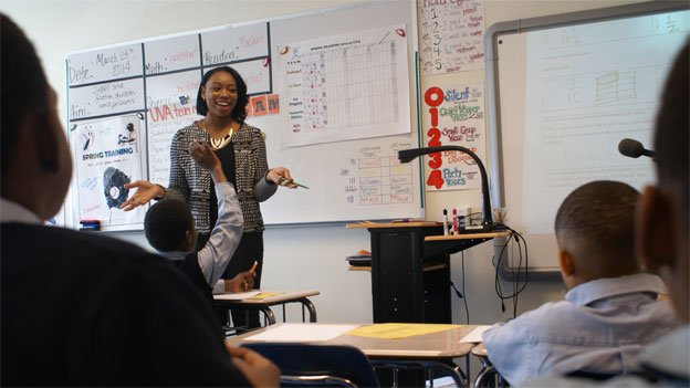 Isi Ojeabulu teaches math at DC Prep Edgewood Campus on March 24, 2014.