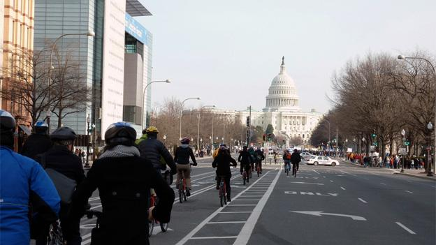 Tourists bicycle down Pennsylvania Ave. towards the Capitol, where lawmakers are now addressing safety concerns.