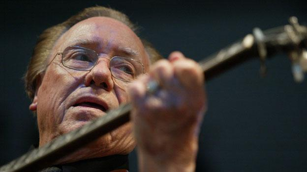 Earl Scruggs performs at the Bonnaroo Music & Arts Festival in Manchester, Tenn. in 2005.