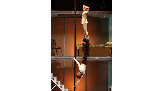 Acrobats from Les 7 Doigts de la Main execute tricky acts of physical strength and balance.