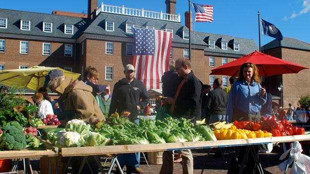Shoppers browse at the Old Town Farmers Market in Alexandria, Va., which is the oldest continuous market in the country. After decades, the city is pushing back the market's weekly start time from 5:30 a.m. to 7 a.m.