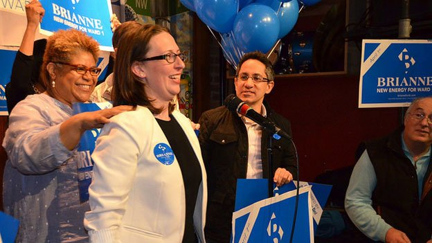 Brianne Nadeau, second from left, celebrates with campaigners at Solly's U Street Tavern in Ward 1.