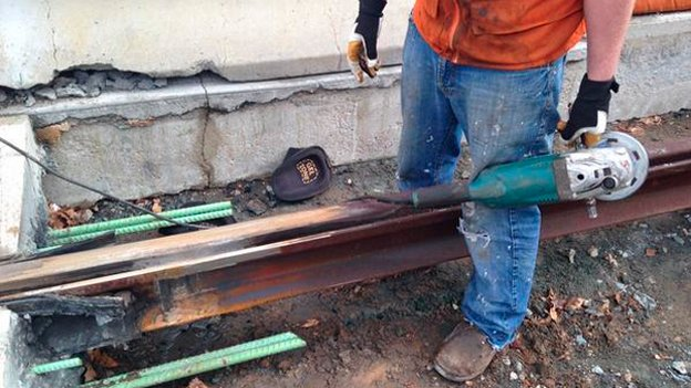 Repairs are underway on a broken rail on the eastern end of Benning Road.